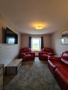 A seating area at Bruxie Holiday Cottages