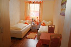 Кровать или кровати в номере Pension Eissler