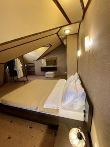 Кровать или кровати в номере Sunlion Баунти Hotel