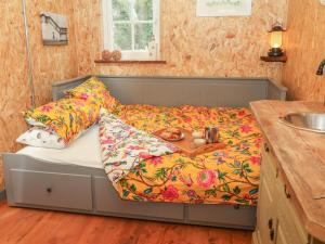 A bed or beds in a room at Bramley Orchard Glamping