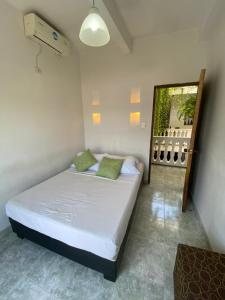 A bed or beds in a room at Patio de Getsemani