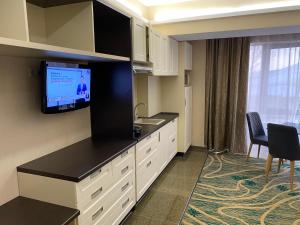 A television and/or entertainment center at Hotel Kazzhol Almaty