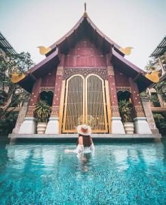 The swimming pool at or close to Burasari Phuket Resort & Spa - SHA Plus