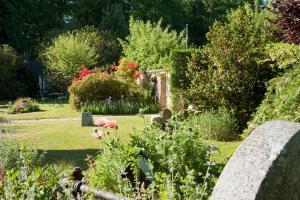 A garden outside Le Manoir du Lys, The Originals Relais (Relais du Silence)
