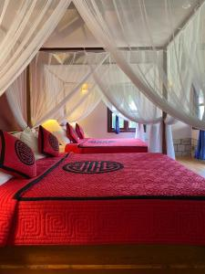 A bed or beds in a room at Mai House Resort