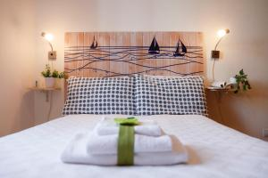 A bed or beds in a room at Il Melo Residence