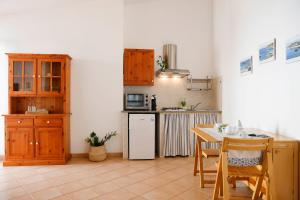 A kitchen or kitchenette at Il Melo Residence
