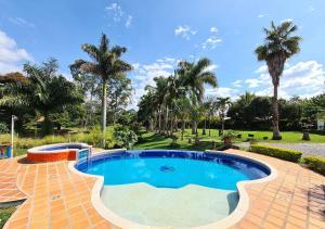 The swimming pool at or near El Percal Hacienda Hotel by DOT Tradition