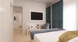 Letto o letti in una camera di Astoria Suite Hotel