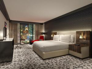 A bed or beds in a room at Hilton Miami Downtown