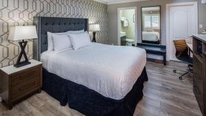 A bed or beds in a room at Stone Villa Inn