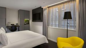 A bed or beds in a room at Park Plaza Victoria Amsterdam