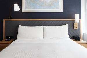 A bed or beds in a room at Club Quarters Hotel Midtown - Times Square