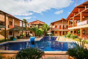 The swimming pool at or close to Pousada Recanto Beach