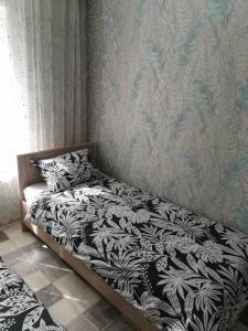 Кровать или кровати в номере Апартаменты на Катукова 4/1