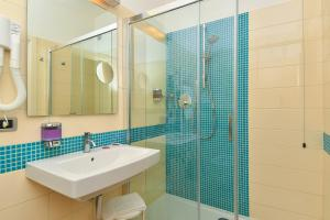 Koupelna v ubytování Centro Vacanze Pra' delle Torri
