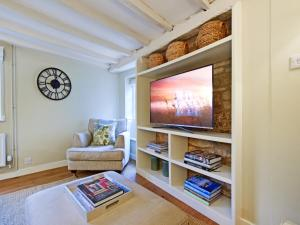 A television and/or entertainment center at Thatch Cottage
