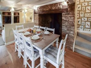 A restaurant or other place to eat at Thatch Cottage