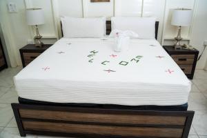 A bed or beds in a room at Fond Doux Eco Resort