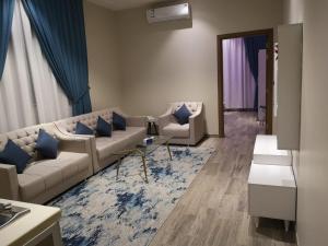 Uma área de estar em Makarem Hotel Apartments