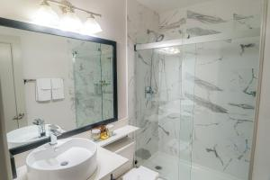 A bathroom at Best Western Plus Sands
