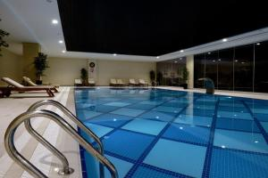 The swimming pool at or near Margi Hotel