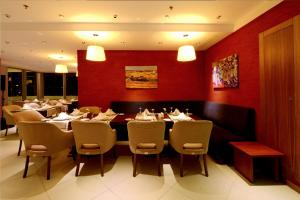 A restaurant or other place to eat at Margi Hotel