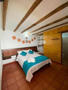 A bed or beds in a room at Hotel - Hospedería Villa Palva