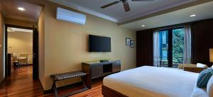 A television and/or entertainment center at The Taaras Beach & Spa Resort