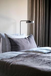 Una cama o camas en una habitación de Hotel Ottilia by Brøchner Hotels