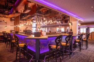 Ein Restaurant oder anderes Speiselokal in der Unterkunft 4*S Galtenberg Resort