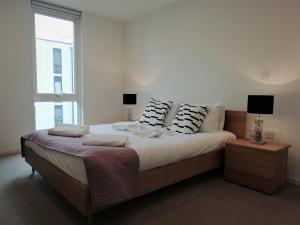 Cama o camas de una habitación en Clerkenwell Serviced Apartments