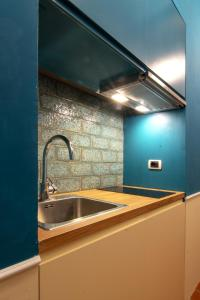 A kitchen or kitchenette at D'Ardiglione27 Flat Studio Nuovo New