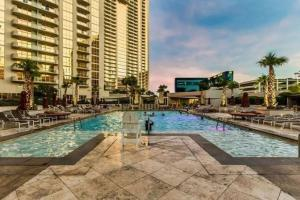 The swimming pool at or near Amazing Strip View 28th Floor at The Signature MGM - 2801