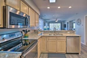 A kitchen or kitchenette at Swim, Golf, Play - Beachy River Oaks Condo!