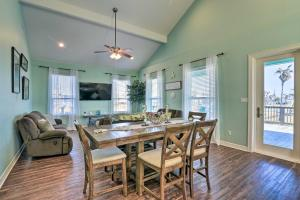 A restaurant or other place to eat at Surfside Getaway with Deck - Walk to the Beach!