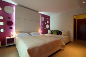 Krevet ili kreveti u jedinici u okviru objekta Domador Rooms & Apartments