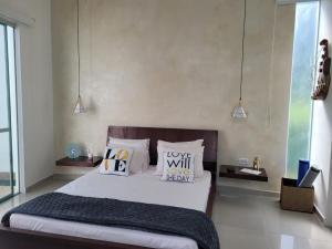 Кровать или кровати в номере Lotus Suite