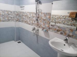 A bathroom at • Faizi Furnished Apartments
