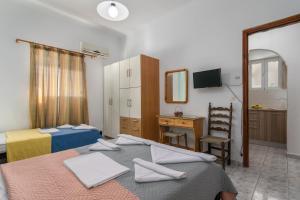 Ένα ή περισσότερα κρεβάτια σε δωμάτιο στο Soulis Studios