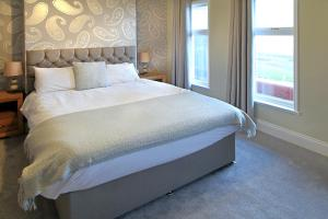 A bed or beds in a room at The Marine Hotel