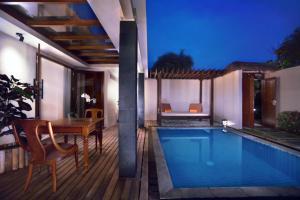 The swimming pool at or near Aston Sunset Beach Resort - Gili Trawangan