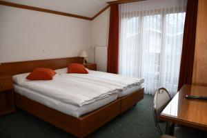 A bed or beds in a room at Elite