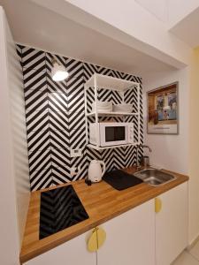 A kitchen or kitchenette at sarà Futura