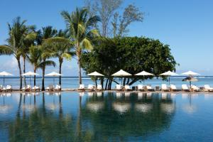 The swimming pool at or close to Outrigger Mauritius Beach Resort