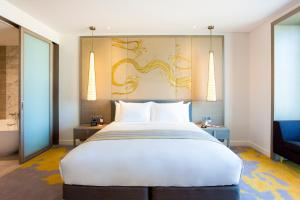 A bed or beds in a room at Crowne Plaza Vientiane, an IHG Hotel