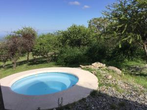 The swimming pool at or near Cabañas Chacras del Arroyo Vidal