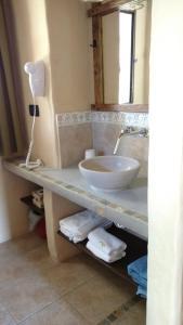 A bathroom at Cabañas Chacras del Arroyo Vidal