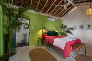 A bed or beds in a room at Casa Jaali