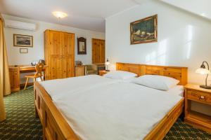 Un ou plusieurs lits dans un hébergement de l'établissement Penzion Kaps